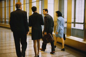 Business People Walking by Window