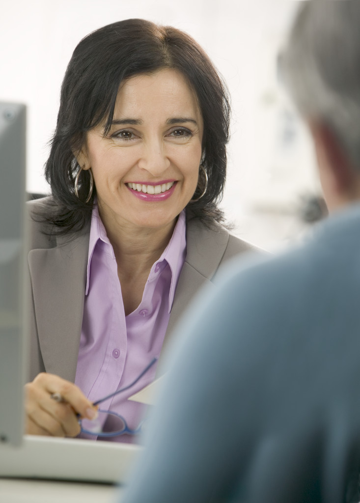 Businesswoman Smiling During Meeting