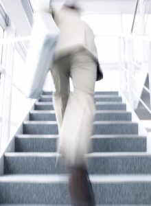 Businessman Running Up Stairs --- Image by © Royalty-Free/Corbis